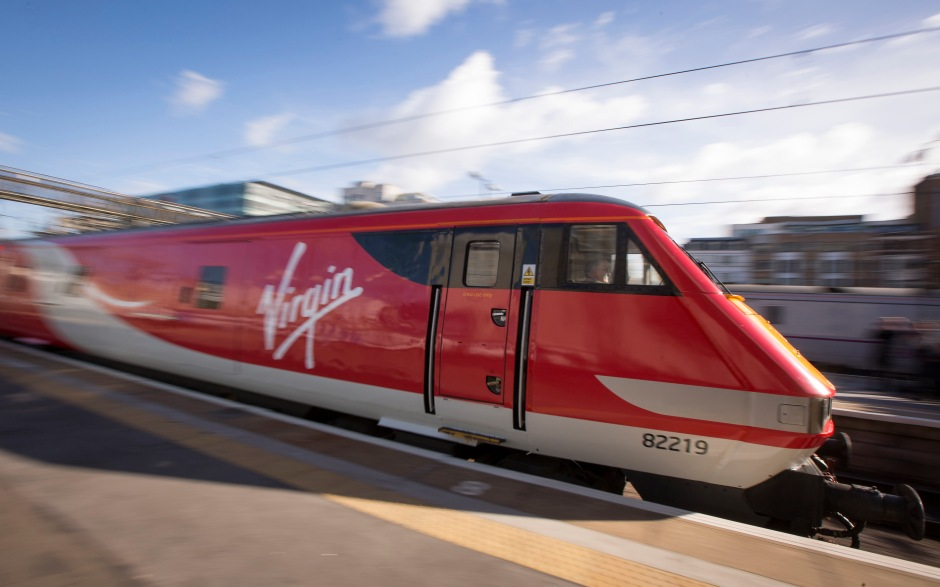 A Virgin Trains East Coast train, operated by Virgin Trains, departs from King Cross station as it begins full operations from London, U.K., on Monday, March 2, 2015. Virgin Trains and partner Stagecoach Group Plc. started their eight year service today on the London-Edinburgh rail route, linking London's Kings Cross station with the Scottish capital via Leeds in northern England. Photographer: Jason Alden/Bloomberg